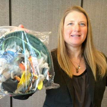 Image: Jenna Jambeck with plastic trash