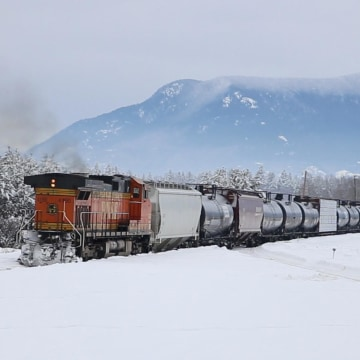 Image: A BNSF oil train heads west through Whitefish, Montana.