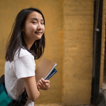Image: ARosa Chen stands in Chinatown where she gives historical tours with the Chinatown Community Development Center.