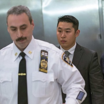Image: NYPD officer Liang departs the criminal courtroom after an arraignment hearing in the Brooklyn borough of New York City