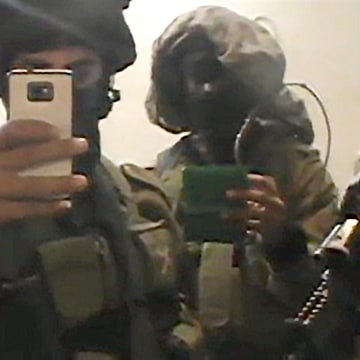 Image: Still from video provided by Israeli human rights group B'Tselem shows Israeli soldiers in a West Bank home photographing and interrogating a Palestinian family on February 25.