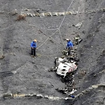 Image: Rescue workers are seen at the crash site of the Germanwings Airbus A320, near Seyne-les-Alpes
