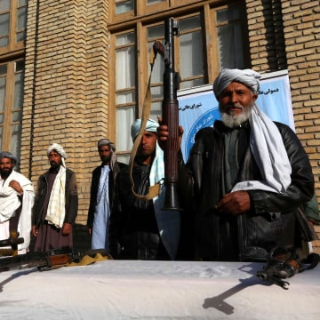 Image: Former Taliban militants surrender as part of reconciliation initiative