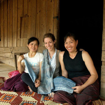 Suda with local partners in Laos in 2010.