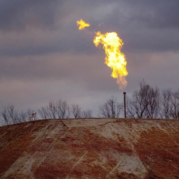 Image: A gas flare burns at a fracking site in rural Bradford County, Pennsylvania