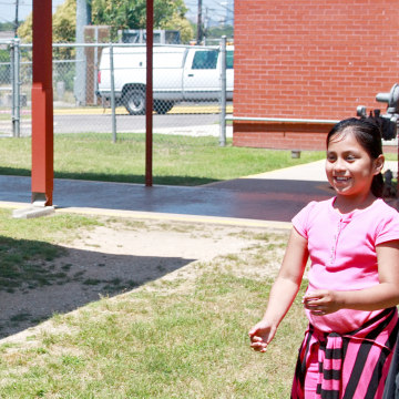 Image: Children and staff participate in the Communities in Schools program