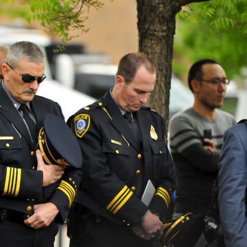 Image: Oklahoma City police officers observe a moment of silence during the 20th Remembrance Ceremony at the Oklahoma City National Memorial and Museum in Oklahoma City