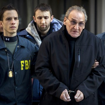 Image: Bonanno crime family leader Vincent Asaro is escorted by FBI agents from their Manhattan offices in New York