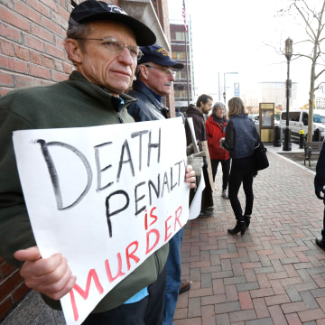 Image: Joe Kebartas protests death penalty.