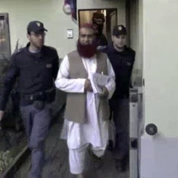 Image: Italian Policemen detain a man suspected to be member of an armed organisation inspired by al Qaeda