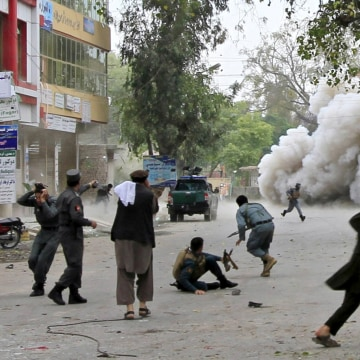 Image: People run for cover after an explosion in Jalalabad