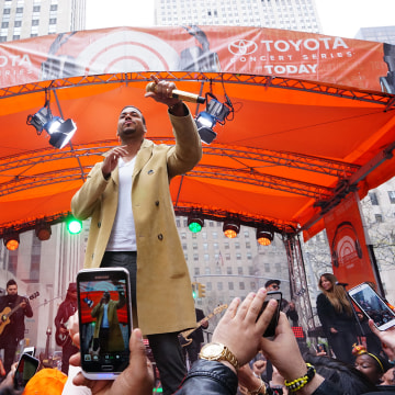 Image: Concert goers take pictures of Romeo Santos