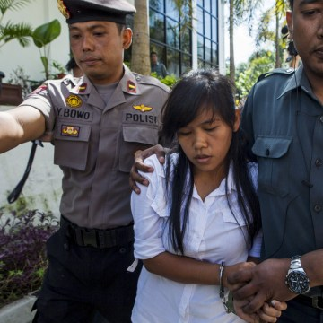 Image: File photo of Mary Jane Fiesta Veloso of the Philippines arriving at her first judicial review trial in the District Court of Sleman inYogyakarta