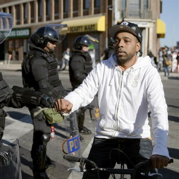 IMAGE: Baltimore resident greets Maryland state trooper
