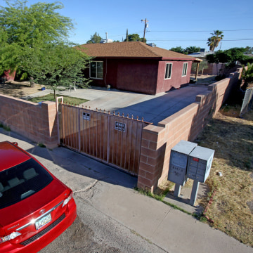 Image: Tuscon home where 5 people were shot to death