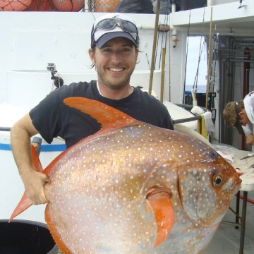 Image: Biologist Nick Wegner holds a captured opah