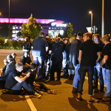 Image: Audience members outside arena