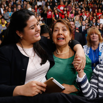 Image: Lorella Praeli, Chela Praeli and Ligia Jimenez (L-R) listen to U.S. President Barack Obama speak about immigration reform