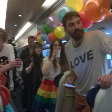 Image: Eoin Gill, wearing a white T-shirt, was among Irish expat voters who traveled home Thursday to vote in the country's gay marriage referendum.