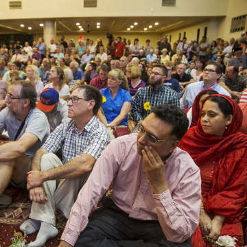 "Image: Hundreds gather for a rally titled ""Love is Stronger Than Hate"" at the Islamic Community Center in Phoenix, USA"
