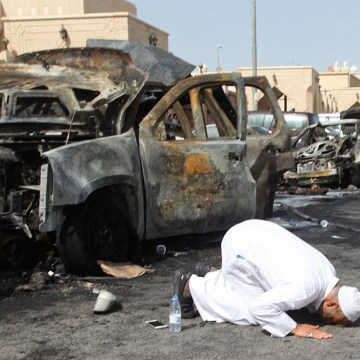 Image: Victim's cousin prays after mosque bombing in Saudi Arabia on May 29