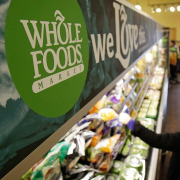 image: woman shops at Whole Foods Market