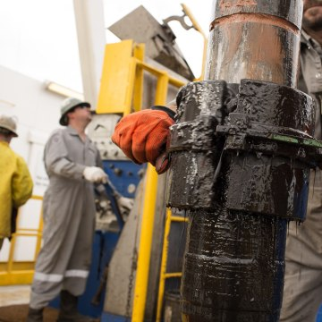 Image: Roughnecks working on an Oklahoma oil well