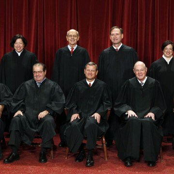 Image: File photo of justices of the U.S. Supreme Court posing for formal group photo in the East Conference Room in Washington