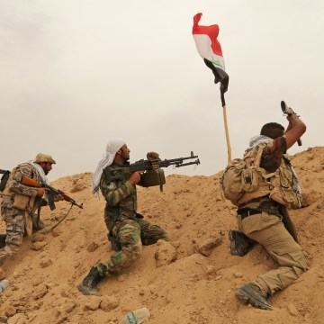Image: Badr Organization fighters clash with ISIS near Fallujah, Iraq, on June 1