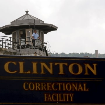 Image: A guard stands in a tower at the Clinton Correctional Facility in Dannemora