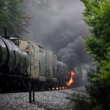 Image: Smoke rises from a CSX train following the derailment of a train car