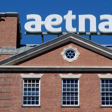 Image: A sign for Aetna Inc., sits atop a building at the company headquarters in in Hartford, Conn.