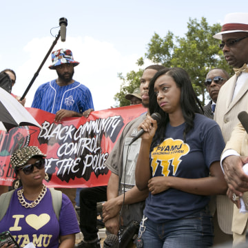 Image: Lanitra Dean, cries as she speaks about her friend Sandra Bland, at the Waller County Courthouse in Hempstead, Texas,