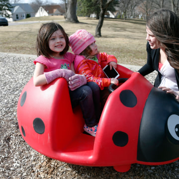 Image: Michelle Halonen enjoys the warm day with daughters
