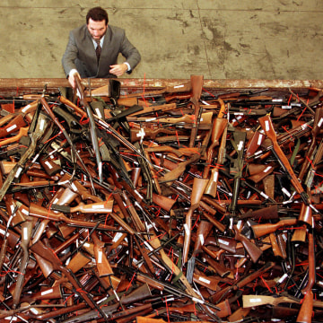 Image: A pile of about 4,500 prohibited firearms