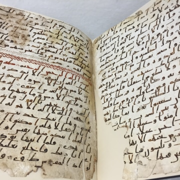 Image: The script consists of two parchment leaves covered in ink in an early form of Arabic script known as Hijazi