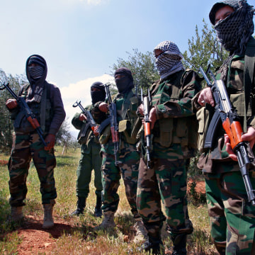 Image: Hezbollah fighters in Lebanon on April 12, 2013