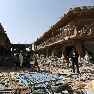 Image: Afghans gather at the site of a truck bomb attack in Kabul