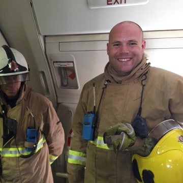 Image: Firefighters aboard United Airlines Flight UA935 on Aug. 7, 2015