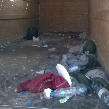 Image: Holes were torn in the truck's roof with the migrants' bare hands