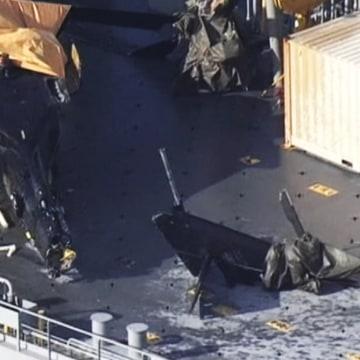 Image: Damaged chopper on deck of U.S. ship
