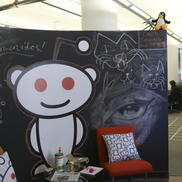 Image: A Reddit mascot is shown at the company's headquarters in San Francisco