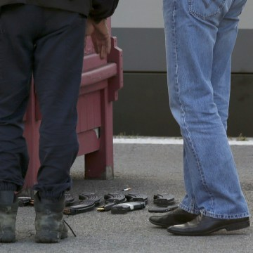 Image: French judicial police stand on the train platform near weapon cartridges and a backpack in Arras after shots were fired on a Thalys high-speed train