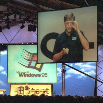 Image: Microsoft Chairman Bill Gates is televised on a big screen as he introduces Windows 95