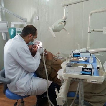 Image: A patient is treated at the Amiriyat Al-Fallujah Refugee camp