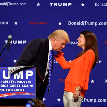 Image: Donald Trump supporter Mary Margaret Bannister checks to see if his hair is real