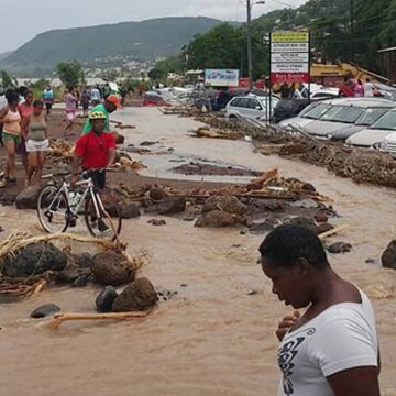 Image: Tropical Storm Erika floods streets in Dominica
