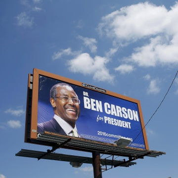 Image: Campaign sign for U.S. Republican presidential candidate and retired Johns Hopkins neurosurgeon Ben Carson is displayed outside the Iowa State Fair in Des Moines
