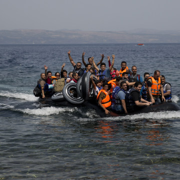 Image: Syrian refugees arrive on Lesbos on Monday