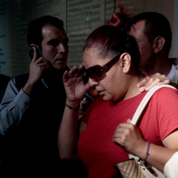 Image: Gabriela Bejarano, sister of Rafael, one of the eight Mexicans killed in an incident in Egypt, leaves the Government Palace after a meeting with local officials in Guadalajara